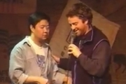 Stand up comedy => Zack Galifianakis and Ken Jeong doing stand-up in 1996